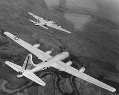 B-17 Flying Fortress bomber and B-29 Superfortress bomber in flight together during a test conducted by Boeing, circa late 1944, photo 1 of 3