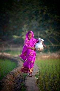 We take water for granted. Most people around the world don't - they are grateful when they have enough to get through another day. Happy girl, carrying water jar, David duChemin – World & Humanitarian Photographer, Nomad, Author. » Global Good