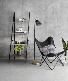 kmart black leather butterfloy chair in industrial living room