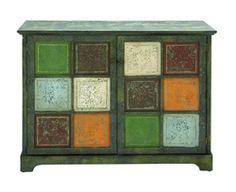 This wooden cabinet works wonders as a television stand for any room. The two large wooden doors can hide away all the unsightly accessories without a second thought. The finish is a dark green buffed away to reveal a lighter green underneath, for a truly eye-catching piece of furniture. The panels on each door all have their own color chosen from an autumn palate.