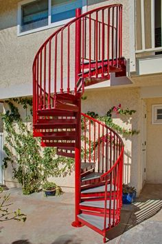 The latest photos and images of Metal Spiral Staircases and Stairs built by The Iron Shop.