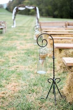 Fall wedding rustic ceremony aisle marker idea - clear glass mason jars filled with baby's breath + burlap {Michelle Lea Photographie}