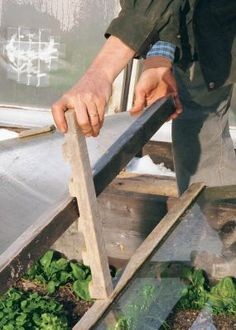 neat idea for hold up cold frames when you need to adjust the temperature
