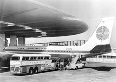 A daytime view of the Pan American World Port Terminal 3 at Idlewild Airport (JFK) in New York, in a joint publicity shot for the airline and Eastern Greyhound Lines. It features Boeing 707 and a 1954 Greyhound designed by Raymond Loewy. Bus City, International Airlines, International Airport, Boeing 707, Pan Am, Commercial Ads, Bus Coach, Site Web, Air Travel
