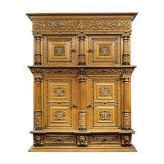 A DUTCH OAK AND EBONISED CUPBOARD RENAISSANCE, 17TH CENTURY extensively carved with figures, birds and scrolling foliage, with four panelled doors opening to a plain interior, the sides with raised panels, all above two short frieze drawers, restored height 217cm., width 157cm., depth 66cm.