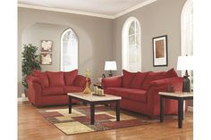 contemporary styled red couch and red love seat with pillow back and flared arm rests