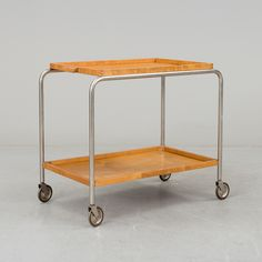 A 1940s serving trolley Length 70, width 43, height 62 cm