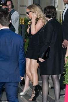 Hot to trot: Mariah Carey left little to the imagination as she was pictured leaving her Paris hotel in a body-baring LBD ahead of her concert in the French capital on Thursday evening