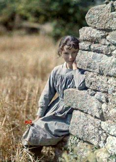 Antique Edwardian autochrome photo, early 1900's (restored) Girl leaning against a wall by Gustave Gain.