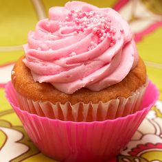 A delicious vanilla cupcake recipe with fun pink frosting. Vanilla Cupcake with Pink Frosting Recipe from Grandmothers Kitchen.