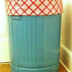 Cute laundry basket by painting a metal trash can and sewing a liner. I know you can buy identical cans at IKEA. 