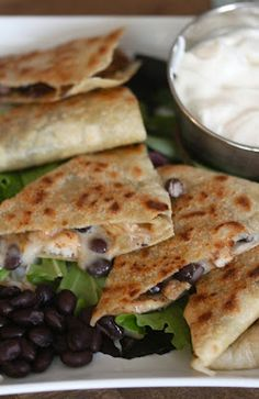 Cookbook Confessions: Chicken and Black Bean Quesadilla. A good vegetarian version would be replacing the chicken with fresh avocado slices after you cook the quesadilla.