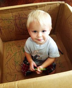Empty box + Crayons = quiet activity for your two year old.