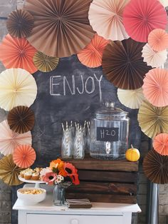 love this simple set up- great backdrop, water, glasses and mini cupcakes on a small dresser.