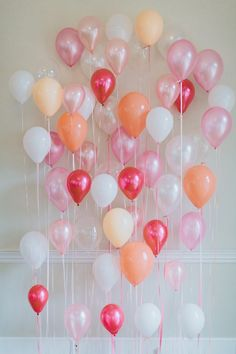 multicolored balloon backdrop - photo by Brian Schindler; styling by Studio Cultivate   http://ruffledblog.com/madison-james-2017-collection/