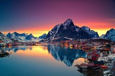midnight-sun-in-lofoten-norway. Reine is a small Norwegian fishing village nestled in the Lofoten Archipelago, a picturesque string of islands within the Arctic Circle. Lofoten, Oh The Places You'll Go, Places To Travel, Travel Destinations, Places To Visit, Travel Tourism, Cruise Travel, Beautiful Norway, Beautiful World