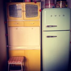 Vintage kitchen larder. The hatch comes down to form a little ledge which is really handy for preparing food and drinks. It still has the original paint and glass which is just lovely! Smeg fridge in mint green. Vintage kitchen step ladder.