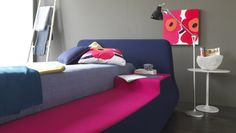 Teen bedroom design ideas: this cool custom bed is fantastic, fluffy and multicoloured. A perfect example of pop art furniture and functioning design: the attached nightstand makes it a whole, stylish, comfortable bed.