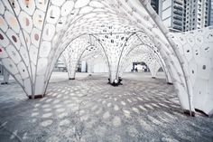 Date: 2012 Size: 8m x 8m x 3m Materials: 4mm Translucent Coroplast, Nylon Cable Ties, Steel Foundations, PVC and Steel Reinforcement Arches Tools: Rhino, Grasshopper, Kangaroo, Python, Lunchbox, Rhinoscript Location: Wan Chai, Hong Kong Event: Detour 2012