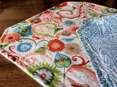 Today I made a set of reversible placemats. This would be a great first project for anyone new to using a sewing machine, and would make a quick and easy housewarming gift. Here's how I did it. • I...