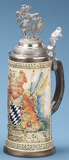 Stoneware, raised-relief, hand painted tribute to this famous German State. The main subject panel shows the Bavarian lions, flags and shield, and �Gott mit Dir, Du Land der Bayern� (God be with you, Bavaria). Baroque pewter lid displays a Bavarian lion and shield figurine. Limited edition of 4,000 pieces.