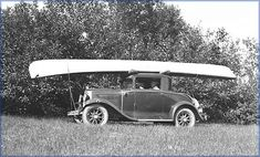 Henry Chestnut, founder of Chestnut Canoe in his roadster with his canoe on top in the early 1930's.