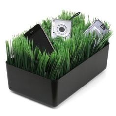 Grass Charging Station: This grass charging station is a fun twist on the popular charging stations you see available to recharge your electronic devices (cellphone, cameras, ipods, etc) without having any exposed power cords.