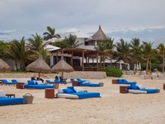 Inviting day beds provide an exclusive retreat on Maroma's beach, riviera Maya, Mexico.(c)  2012 Nathan DePetris
