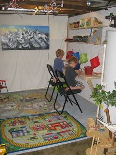 Art, craft, dino dig, treasure area for kids.  Your basement doesn't have to be finished to be fun.  Create a peg board wall, desk and shelves to make a special 'work' area for the kids.  (hanging baskets are from ikea)