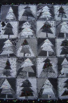 Jessica's quilting studio...a study in value.. i like black and white quilts