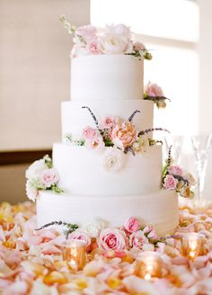 Four tier rose topped spring wedding cake: http://www.stylemepretty.com/2017/01/26/pink-black-tie-wedding/ Photography: Lacie Hansen - http://laciehansen.com/