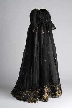 1808-1814. The colored embroidery at the hem of this dress is in beautiful contrast with the sheer black base fabric.