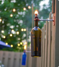DIY Recycled Wine Bottle Torches - Tiki Lights for the deck. Lord knows I have plenty of empty wine bottles. Reuse Wine Bottles, Wine Bottle Lanterns, Wine Bottle Tiki Torch, Recycled Wine Bottles, Bottle Lights, Bottle Candles, Bottle Lamps, Empty Bottles, Beer Bottles