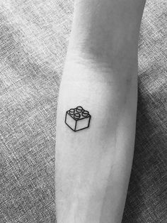 Lego brick tattoo