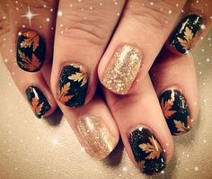 Black nails with maple leaves and giltter accents #nailart #thanksgiving #womentriangle