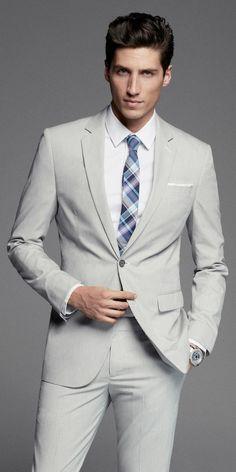 Salt colored suit with plaid tie.