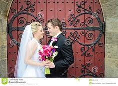 Loving wedding shot in front of ornate door