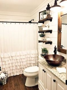 So happy with our bathroom remodel. We went for the farmhouse look. From the shiplap walls to the copper sink, it was an amazing transformation!!