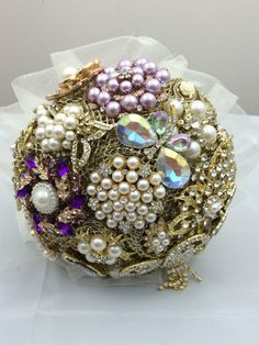 Gold and Purple Brooch bouquet 9 inch by Lovefromlilywedding on Etsy https://www.etsy.com/listing/169517176/gold-and-purple-brooch-bouquet-9-inch