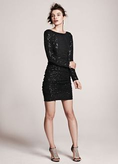 So cute!    You will have no problem standing out while looking fabulous in this stunning all over sequin dress!  Long sleeve bodice features all over dazzling sequin accents.  Ruching detail helps shape a flattering silhouette.  Fully lined. Back zip. Imported poly/nylon/elastane/metallic blend. Professional spot clean.