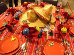 """Right on time for Cinco de Mayo this table was called """"Sombrero Fiesta."""" Centerpieces are the sombreros surrounded by colorful hand-painted pottery animals Check out the gummy worms at the bottom of the Margarita glasses 