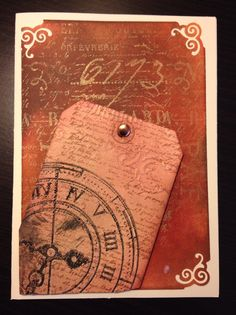 Distressed mount, with distressed tag, embossed with my new clock embossing folder (and Black Soot ranger distress ink)