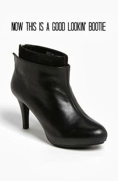 black leather bootie with suede accents and a zipper in the back!  great alternative for a basic heel!