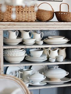 Antique ironstone & baskets in painted cupboard - Ellie Campbell's home (Frog Goes to Market)