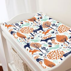 Changing Pad Cover in and Navy and Orange Woodland Animals by Carousel Designs.