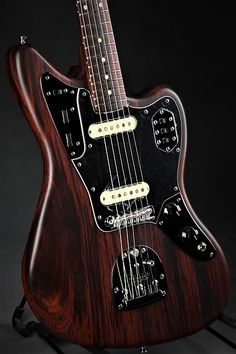 This Fender Custom Shop Rosewood Jaguar solidbody electric guitar is a classic design, crafted by Master Builder Greg Fessler with a warm-sounding tonewood twist.