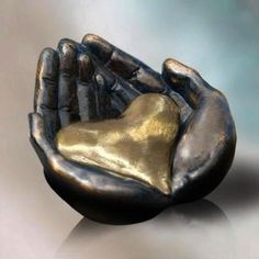God holds us in the palms of His hands...love this sculpture.