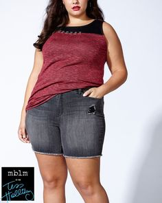 "Make a street-style statement in this trendy plus-size tank top from mblm by Tess Holliday. Crafted from a soft and stretchy jersey fabric, it features a rounded neck with contrasting trim and hook and eye detailing, wide straps and a high-low hem. Wear it with a jean short! Length: 29"" at front, 32"" at back"