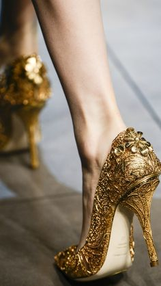 Wow... Intricately detailed gold heels.