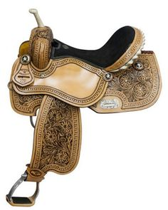 Double T barrel saddle with floral tooling and black inlay. Saddle features inskirt riggin, rawhide silver laced cantle and rawhide braided horn. Saddle is accented with clear rhinestones and silver s
